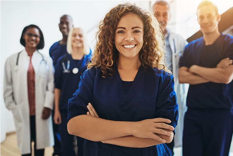 Standing medical professionals smiling at camera